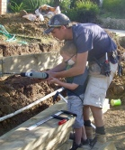 This 1...building garden retaining walls...passing on skills from 1 generation to next:)