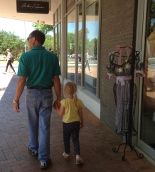 Tony with our granddaughter in Manuka...nice to walk in and around this village